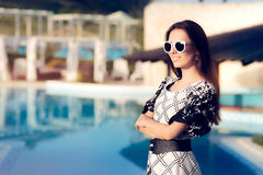 Happy Summer Woman With Sunglasses by the Pool Royalty Free Stock Photo