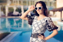 Happy Summer Woman With Sunglasses by the Pool Stock Images