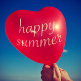 Happy summer written in a heart-shaped balloon, with a retro eff Royalty Free Stock Photo