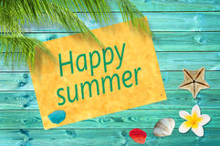 Happy summer written on a paper on colorful wood background with palm trees Stock Photos