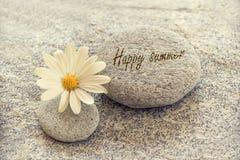Happy summer written on zen pebbles Stock Image