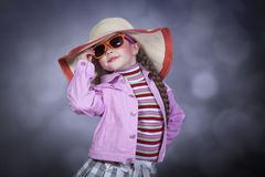 Happy summery girl. Wearing a hat and sunglasses Royalty Free Stock Image
