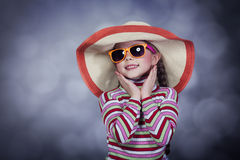 Happy summery girl. Wearing a hat and sunglasses Royalty Free Stock Photography