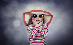 Happy summery girl. Wearing a hat and sunglasses Stock Photos