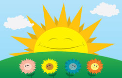 Happy Sun with Flowers. Large sun smiling with flowers in the foreground Royalty Free Stock Photography