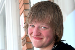 Happy Sunburned Teen. Closeup of a smiling sunburned teenage boy outdoors, looking to his left toward the viewer Stock Photography