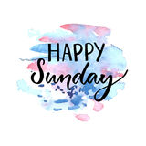 Happy Sunday inscription. Handwritten text on blue and violet watercolor stain. Stock Photos