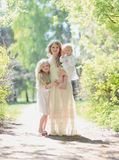 Happy sunny family, mother with her daughters. In a warm summer day Royalty Free Stock Photography
