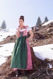 She is happy in sunshine in Dirndl Stock Photo