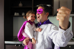 Happy superhero father and child Royalty Free Stock Photos