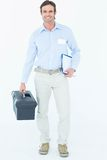 Happy supervisor carrying tool box and clipboard. Portrait of happy supervisor carrying tool box and clipboard over white background royalty free stock photography