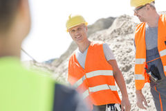 Happy supervisor with colleague at construction site Stock Photos