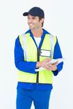 Happy supervisor writing notes on clipboard. Over white background Stock Images