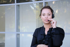 Happy support phone operator in headset Stock Image