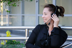 Happy support phone operator in headset Royalty Free Stock Photography