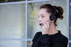 Happy support phone operator in headset Royalty Free Stock Photo