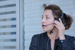 Happy support phone operator in headset Royalty Free Stock Photos