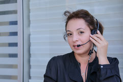 Happy support phone operator in headset Stock Photos
