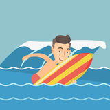 Happy surfer in action on a surfboard. Young caucasian man having fun during execution of a move on an ocean wave. Happy surfer in action on a surfboard Stock Photo