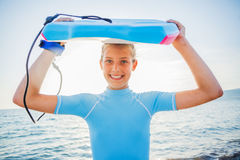 Happy Surfing girl. Royalty Free Stock Photography