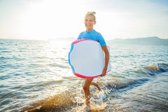 Happy Surfing girl. Royalty Free Stock Photos
