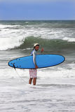 Happy surfing man on bali island. Going to surf on bali island Stock Photo