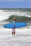 Happy surfing man on bali island Stock Photo