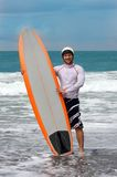 Happy surfing man on bali island. Happy surfing man on island Royalty Free Stock Photo
