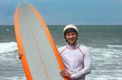 Happy surfing man on bali island. Happy surfing man on the beach Stock Photography