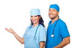 Happy surgeons welcoming Stock Photos