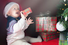 Happy surprised baby holding gift box, present, Christmas, eve Stock Photos