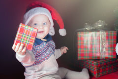 Happy surprised baby holding gift box, present, Christmas, eve Stock Photography