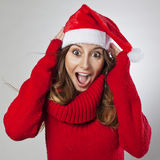 Happy and surprised beautiful Christmas woman Stock Image