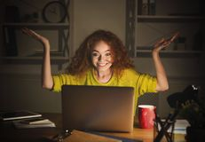 Happy surprised girl with laptop at home office. Happy surprised woman with laptop. Girl at home office looking in computer and celebrating victory. Winner Stock Photos