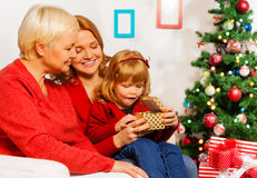 Happy surprised girl opening Christmas present Royalty Free Stock Photo