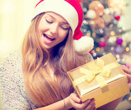 Happy surprised girl opening gift box Stock Images