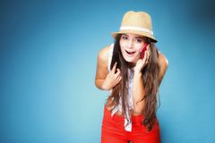 Happy surprised girl talking mobile phone Stock Images
