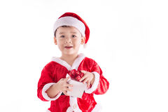 Happy surprised kid with christmas present Stock Photography