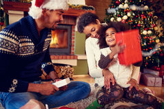 Happy surprised little girl with her parent on Christmas Royalty Free Stock Photos