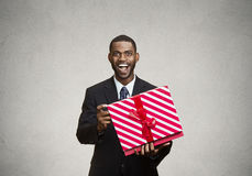 Happy, surprised man receiving gift from someone Royalty Free Stock Images