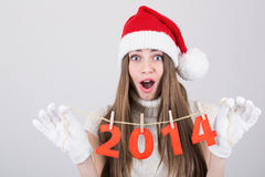 Happy surprised Santa girl holding New Year number decoration Stock Image
