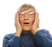 Happy surprised senior woman looking at camera Stock Photos