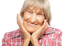 Happy surprised senior woman looking at camera. Isolated on white background Royalty Free Stock Photos