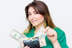 Happy surprised smiling businesswoman wearing in green jacket with wallet and money. Closeup portrait super happy excited successf Stock Images