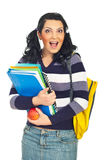 Happy surprised student woman. Holding notebooks and apple looking at camera isolated on white background Stock Image