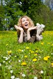 Happy surprised woman on flower field Royalty Free Stock Image