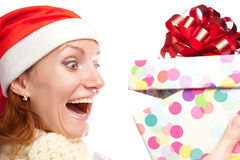 Happy surprised woman opening christmas gift Stock Photo