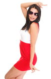 Happy surprised woman in red dress Isolated on Stock Images