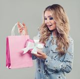 Happy surprised woman with shopping bags royalty free stock image