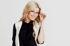 Happy and surprised young confident business lady, looking at camera, white background. Freespace Stock Photography